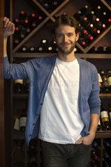 Salesman in wine shop  portrait