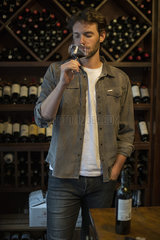 Sommelier sniffing glass of wine