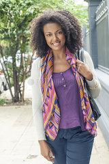 Woman standing on sidewalk  portrait