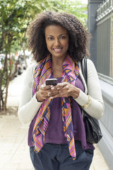 Woman using cell phone  portrait