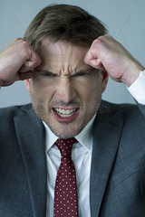 Businessman clenching fists in anger