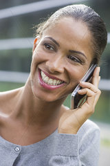Woman talking on cell phone and smiling cheerfully