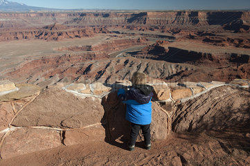 Toddler boy looking at scenic view at Dead Horse Point State Park in Utah  USA