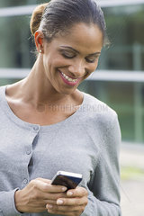 Woman text messaging with smartphone