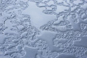 Wet metal surface