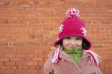Little girl wearing knit hat outdoors  portrait