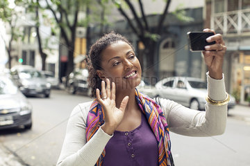 Woman doing video chat on street