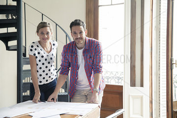 Design team reviewing blueprints