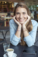 Young woman relaxing at cafe  portrait