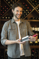 Shopper selecting bottle of wine