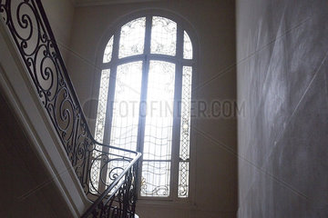 Arched window at top of stairs