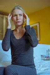 Mature woman suffering a headache