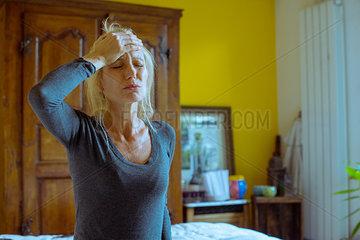 Mature woman experiencing a headache