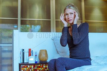 Mature woman experiencing headache