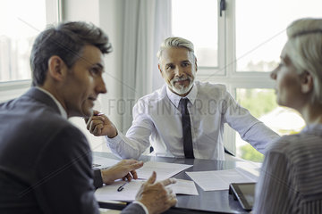 Businessman meeting with couple