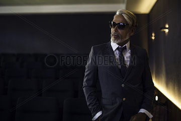 Man wearing suit and sunglasses