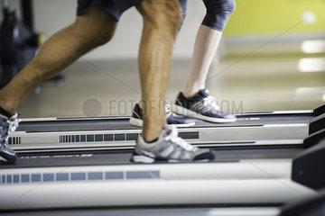 People jogging on treadmills