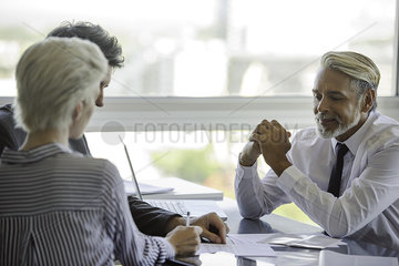 Woman signing document during business meeting
