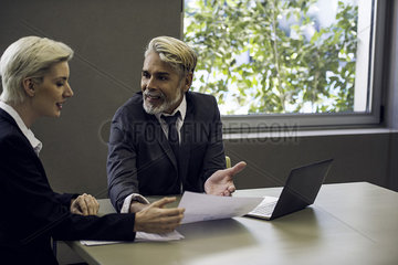 Woman and man meeting in office