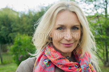 Mature woman smiling outdoors  portrait