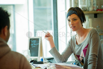 Waitress assisting customer in cafe