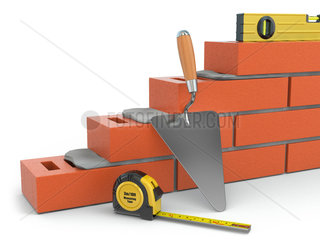Construction concept. Brick wall trowel and level