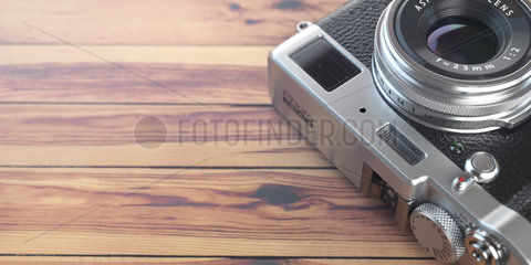 Retro vintage camera on wood table background. Space for text.