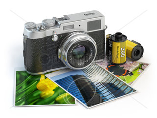 Photo camera and images and film canisters isolated on white.