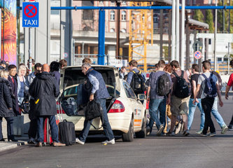 At a taxi holding square in front of the main train station in Berlin