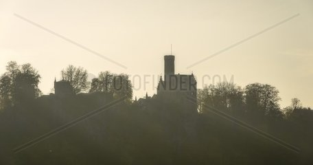 Panoramic view of Lichtenstein Castle in fall in the backlight of sundown  Lichtenstein  Germany.