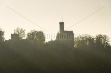 View of Lichtenstein Castle in fall in the backlight of sundown  Lichtenstein  Germany.