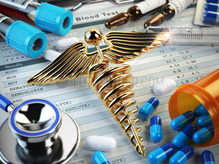 Healthcare medical concept. Pills  capsules  stethoscope  syringe and caduceus sign on the blood test results.