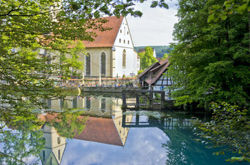 View of the old historic hammer forge at the so called Blautopf across the spring of the river Blau  Blaubeuren near Ulm  Germany