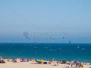 Tarifa  SPAIN -JULY 25  2014 Beach Punta Paloma of Tarifa mit Badeurlaubern und Wind- und Kite Surfer