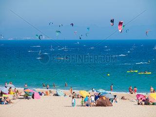 Tarifa  SPAIN -JULY 25  2014 Strand Punta Paloma  Tarifa Mir Badegaesten und Wind- und Kite Surfer