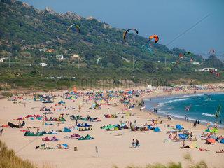 Tarifa  SPAIN -JULY 25  2014 Strand Punta Paloma Tarifa voll mit Badegaesten und Aktivsportlern  wind- und kite surfer