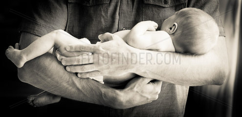 Father Holding Newborn Baby Boy