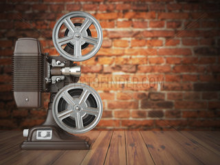 Vintage projector on the bricks background. Cinema  movie or video concept.