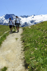 Mother and his son (teen) trekking in the Alps  France  Europe