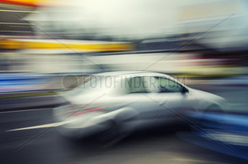 Car driving at excessive speed in a built-up area