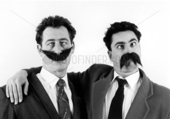 Zwei Maenner mit Bart
