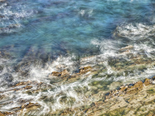 An abstract ocean seascape with blurred motion of a rocky coast