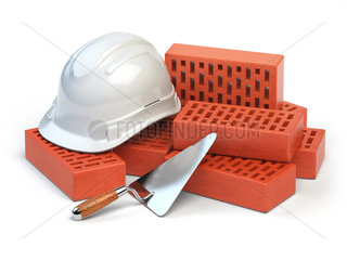 Hardhat  bricks and trowel isolated on white. Costruction concept.