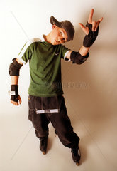 Skater kid with protective pads