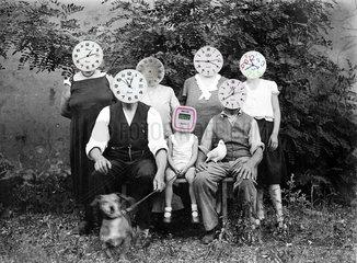 Famile Uhr Koepfe