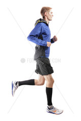 Young attractive athlete running and showing perfect running technique