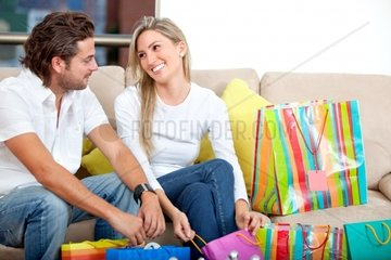Nice couple at home with shopping bags