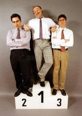 3 Maenner auf dem Siegerpodest