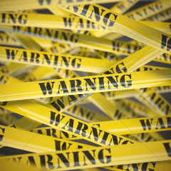 Warning yellow caution tape background. Security concept.