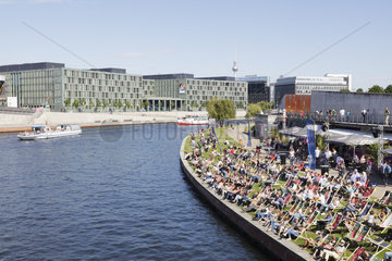 River Spree with people relaxing on deck chairs at Capital Beach Bar  Berlin  Germany